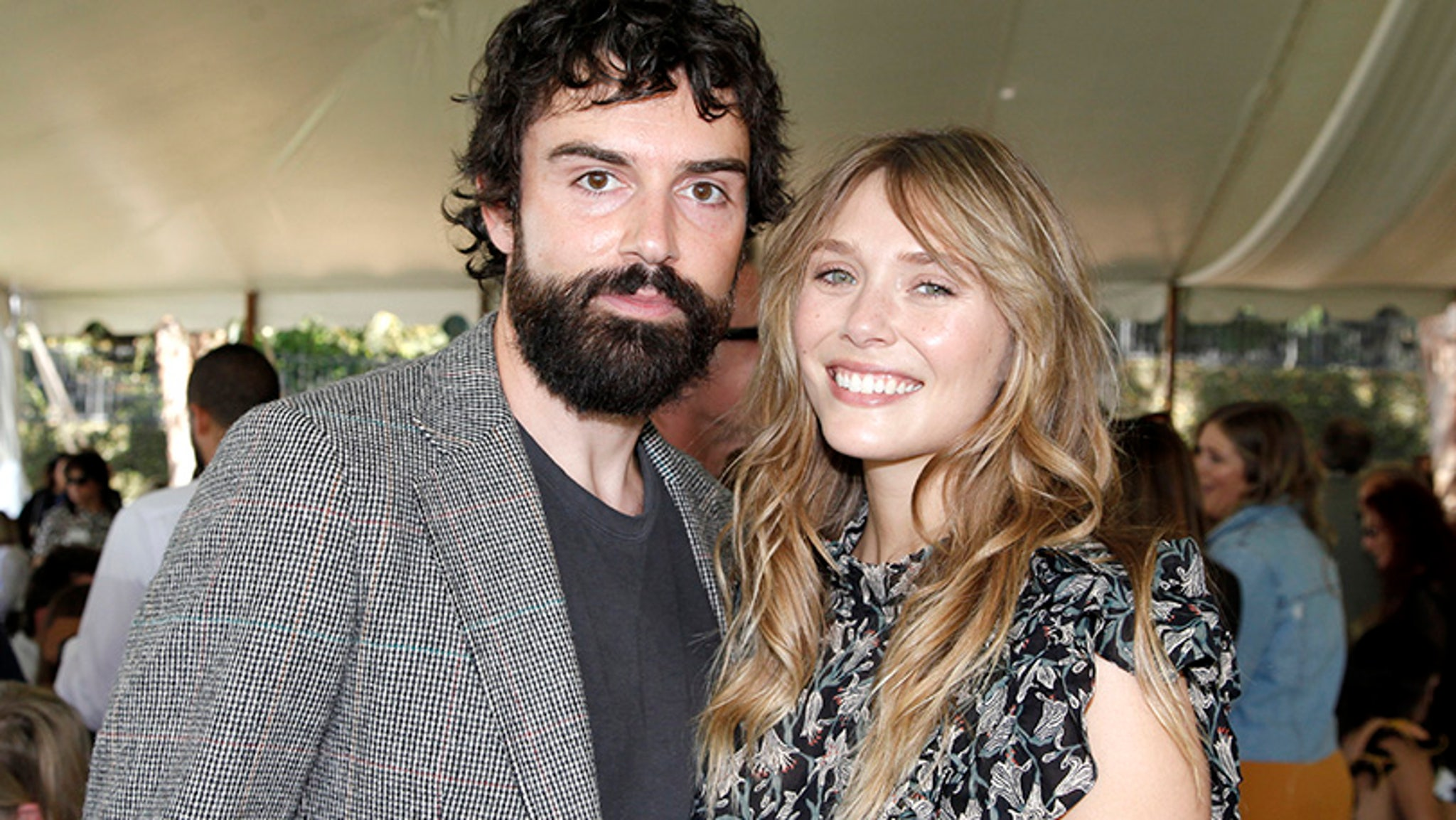 Elizabeth Olsen seems to casually reveal that Robbie Arnett is her 'husband'