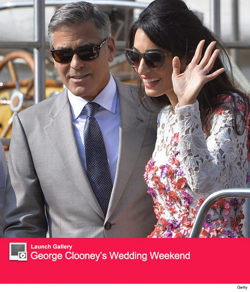 See First Photos Of George Clooney Amal Alamuddin S Wedding Rings