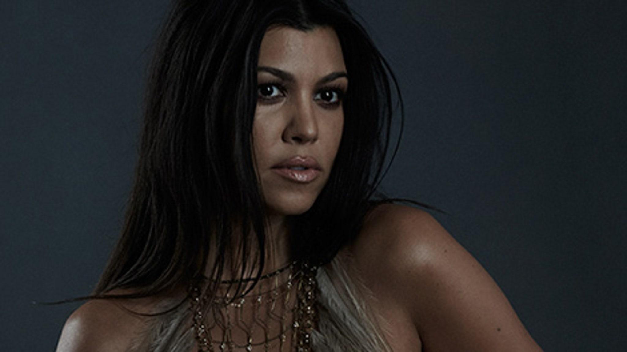 Kourtney Kardashian poses pregnant, nude for magazine